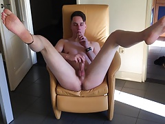 Young gay masturbates in front of the camera