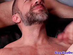 Hunky bear sucking cock with twinks in group