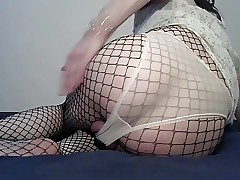 crossdresser in white panties and fishnet suit