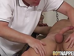 Restrained twink receives a blowjob and candle torment from