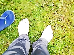 Bare feet on the grass