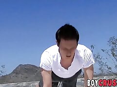Cute young man stretches in the outdoors and then jerks off