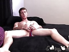 Young redhead loves to stroke his shaved nuts and dick