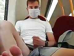 Jerk off with a face mask on the train