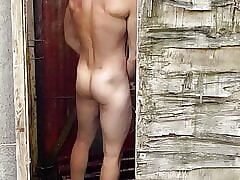 Young Hot Fit Guy in Shower Outdoor