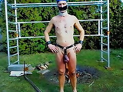 totally naked slave in harness public outdoor BDSM CBT