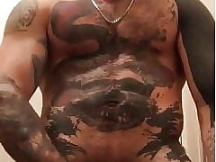 MUSCLE STUD WITH AWESOME TATTOOS  WANK AND TASTES CUM